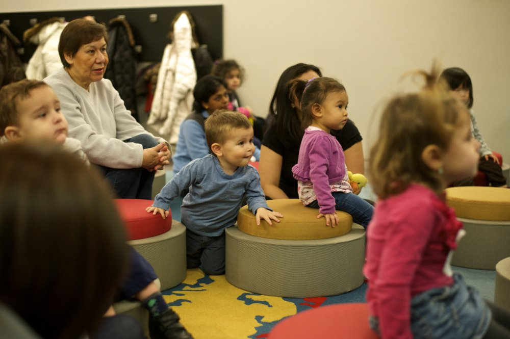 Toddlers enjoy storytime at the library.