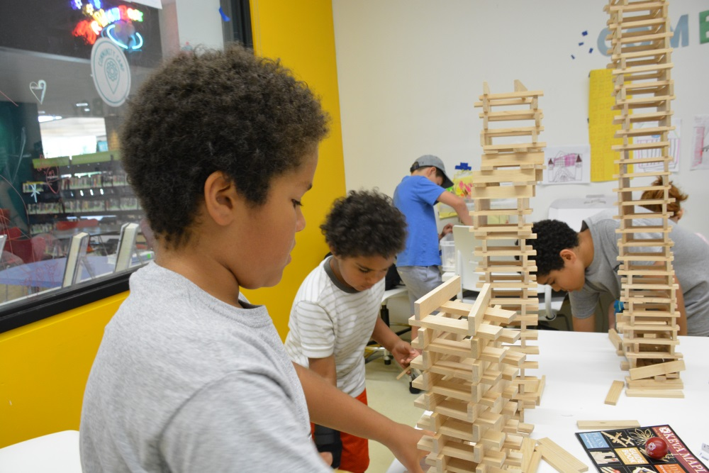 Kids building with KEVA planks